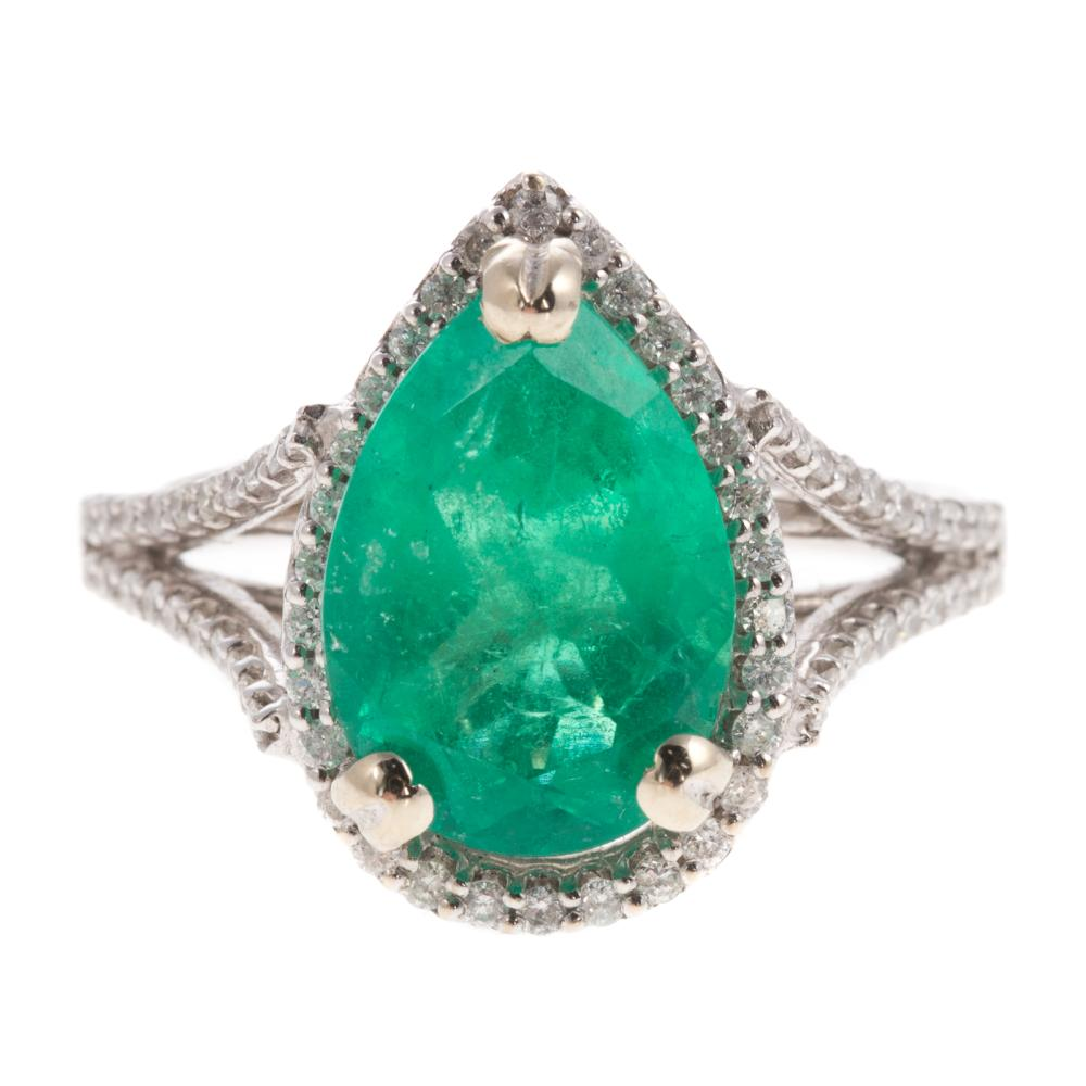 A Ladies Emerald and Diamond Ring in 14K