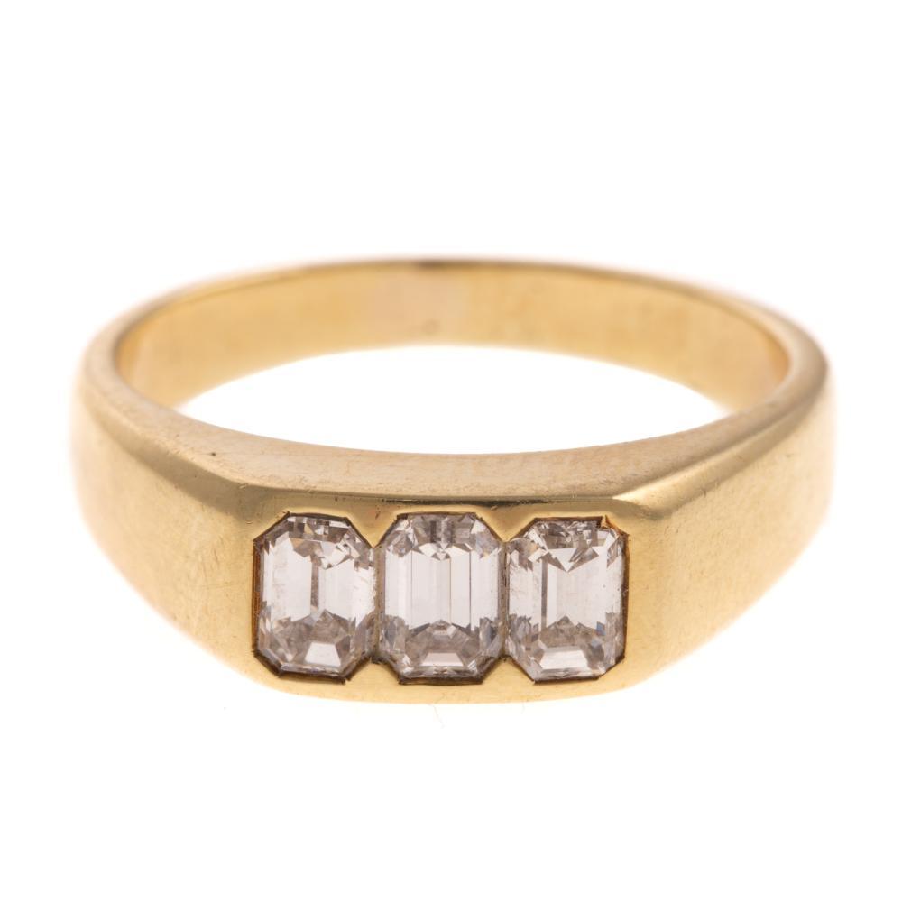 A 3 Stone Emerald Cut Diamond Ring in 18K
