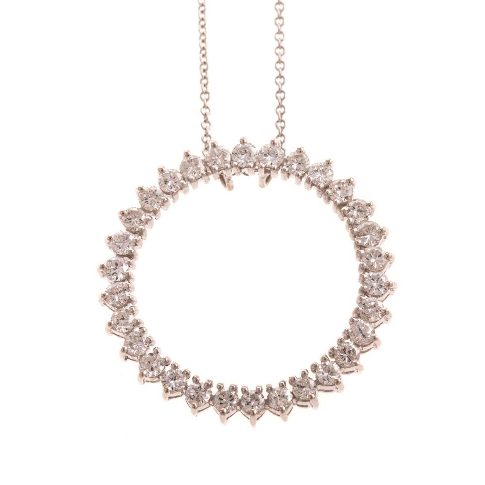 An Open Circle Diamond Pendant with Plat Chain