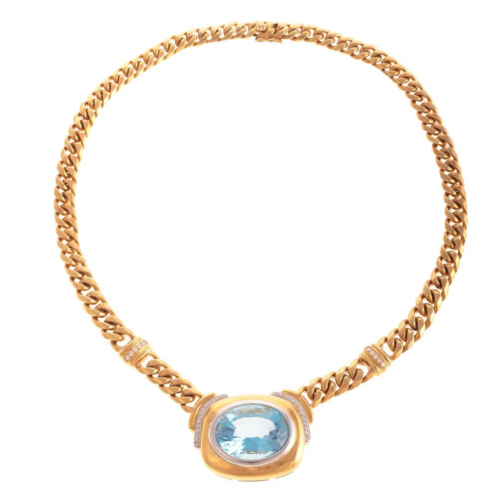 A Ladies Blue Topaz & Diamond Necklace in 18K
