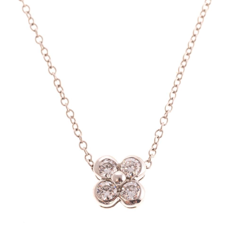 A Tiffany & Co. Diamond Platinum Floral Pendant