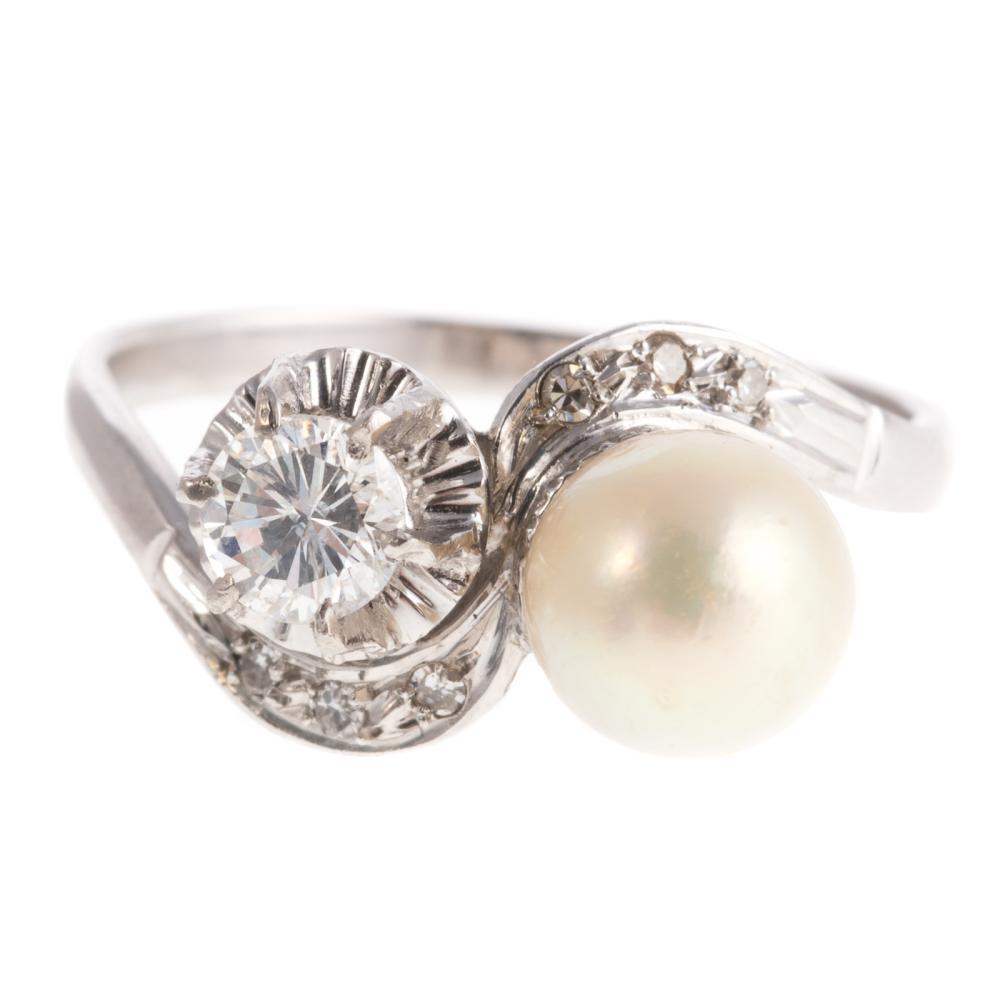 A Ladies Platinum Pearl & Diamond Bypass Ring