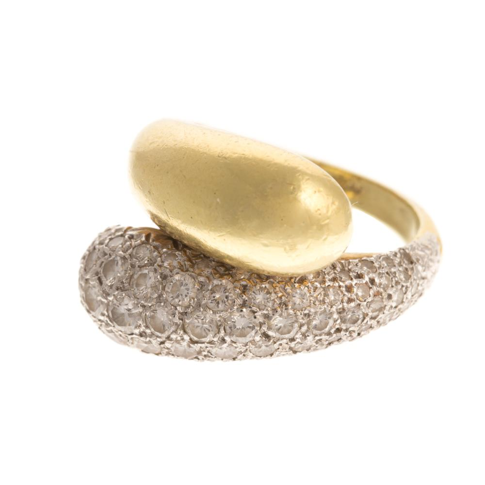 A Ladies 18K Pave Diamond Bypass Ring