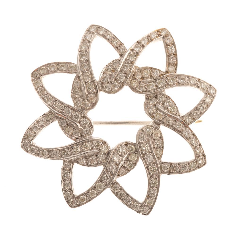 A Ladies 18K Diamond Open Pinwheel Pin