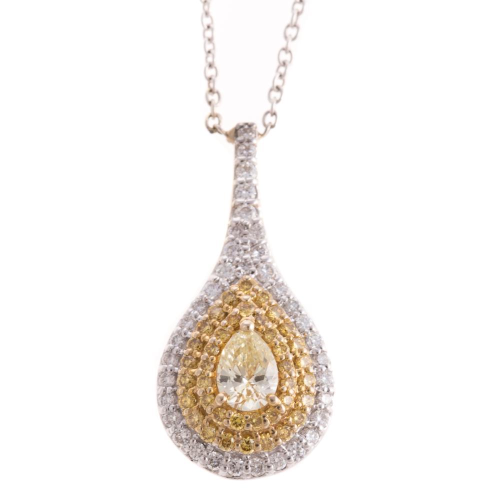 A Pear Shape Yellow Diamond Pendant in 18K