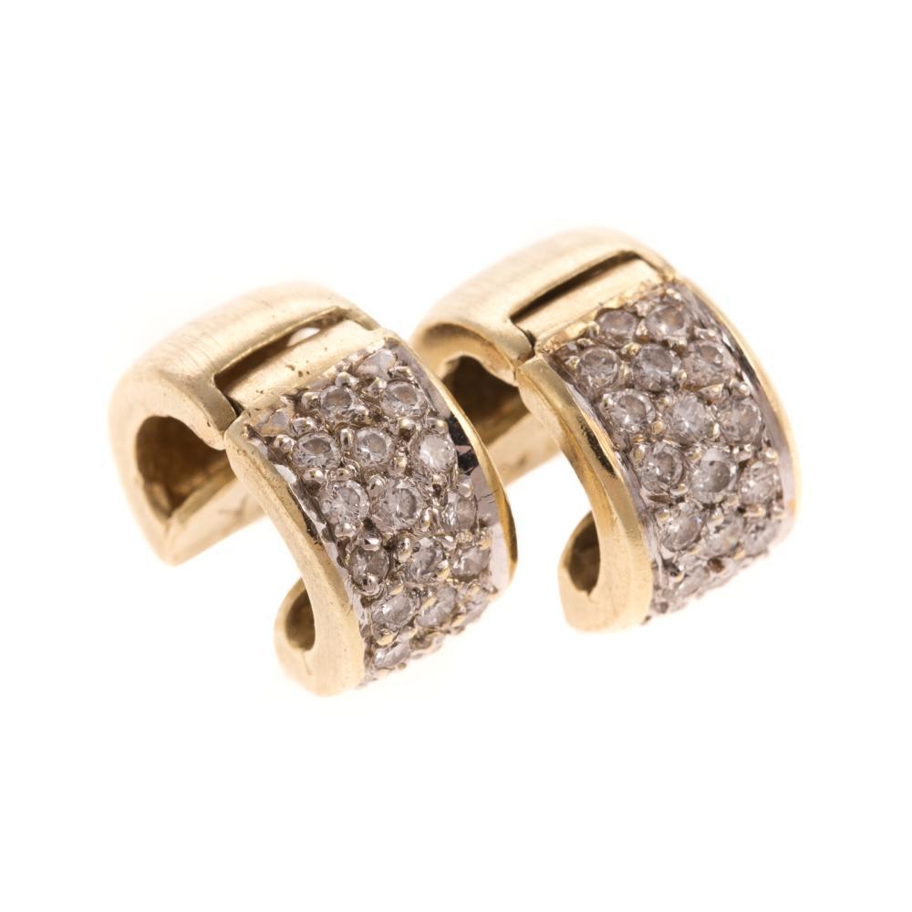 A Pair of Pave Diamond Huggie Earrings in 14K
