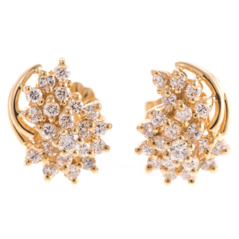 A Pair of Diamond Cluster Stud earrings in 14K
