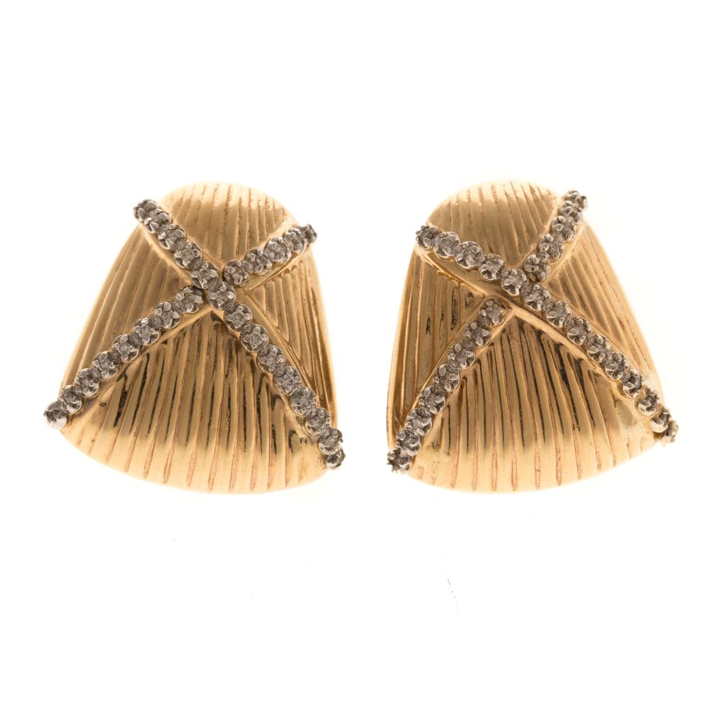 A Ladies Pair of 14K Gold Earrings with Diamonds