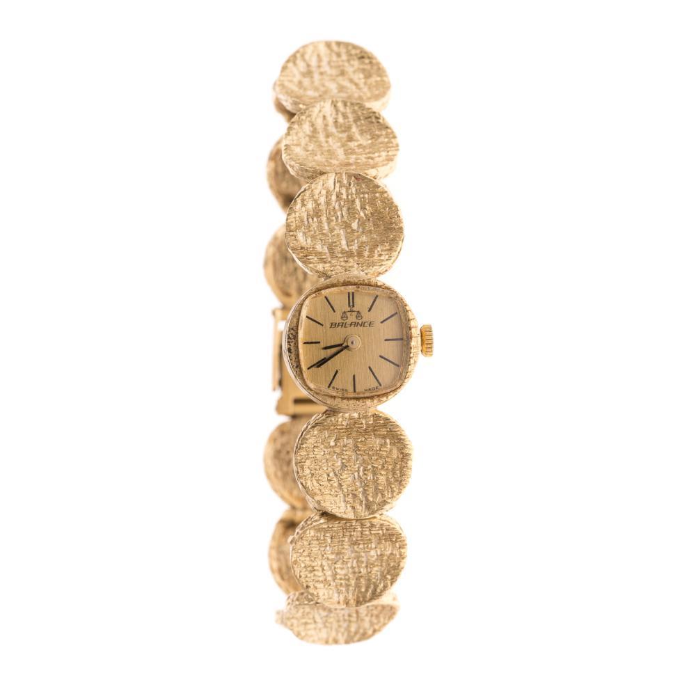 A Ladies Swiss Balance Watch in 14K Gold