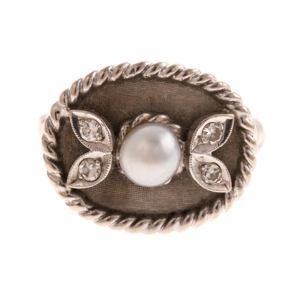 A Ladies Vintage Pearl & Diamond Ring in 14K