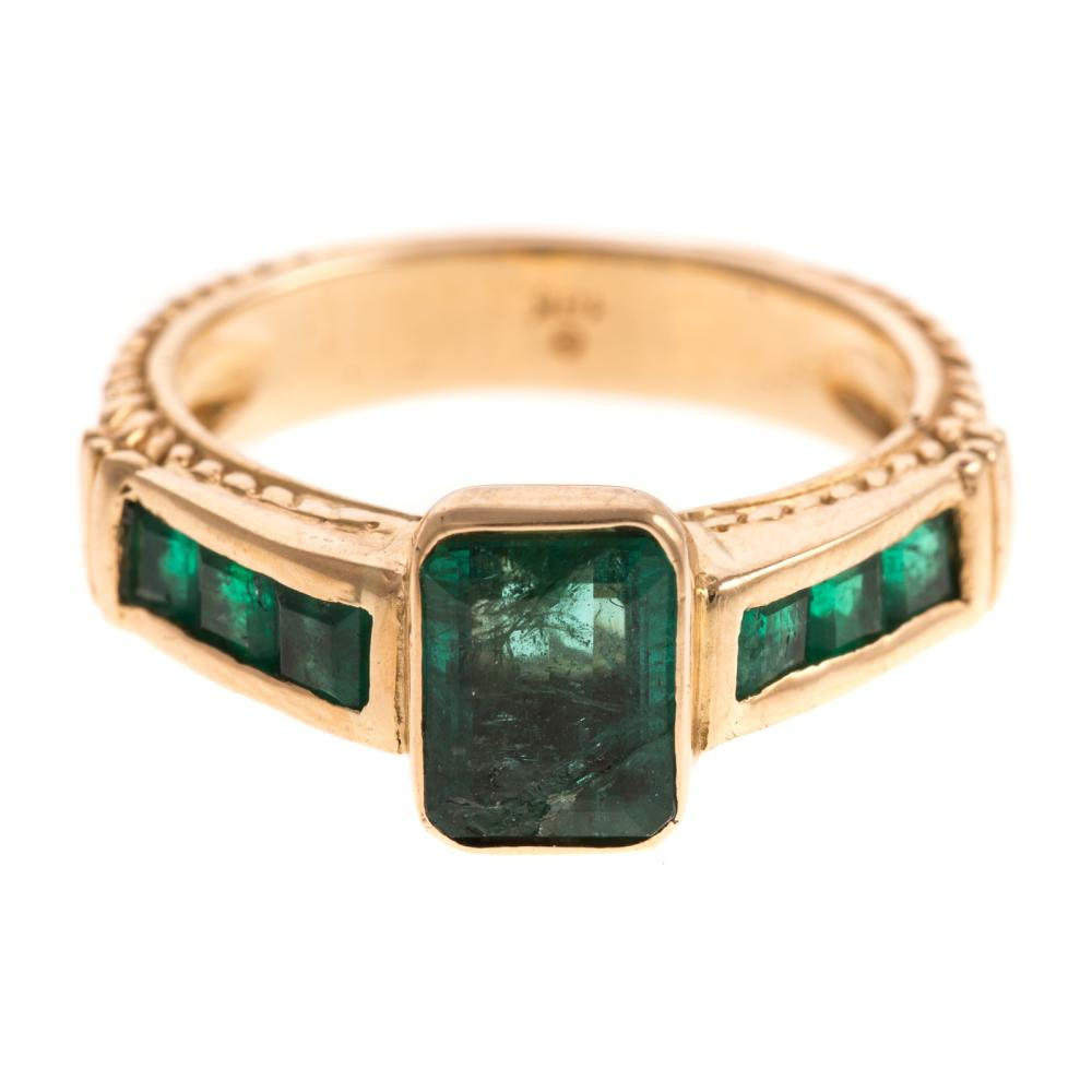 A Ladies Emerald Ring in 18K Gold