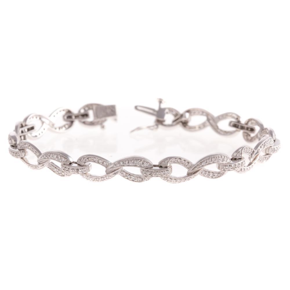 A Ladies Diamond Oval Link Bracelet in 14K Gold