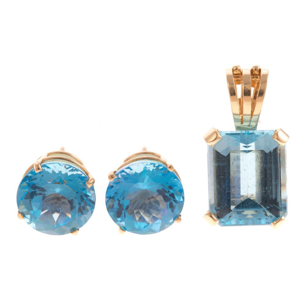 A Ladies Blue Topaz Pendant & Earrings in 14K Gold