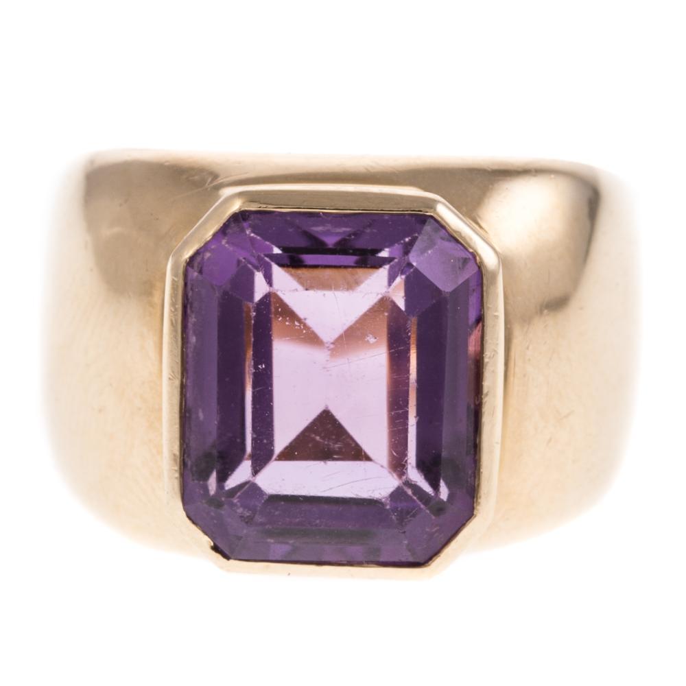 A Ladies Bezel Set Amethyst Ring in 14K