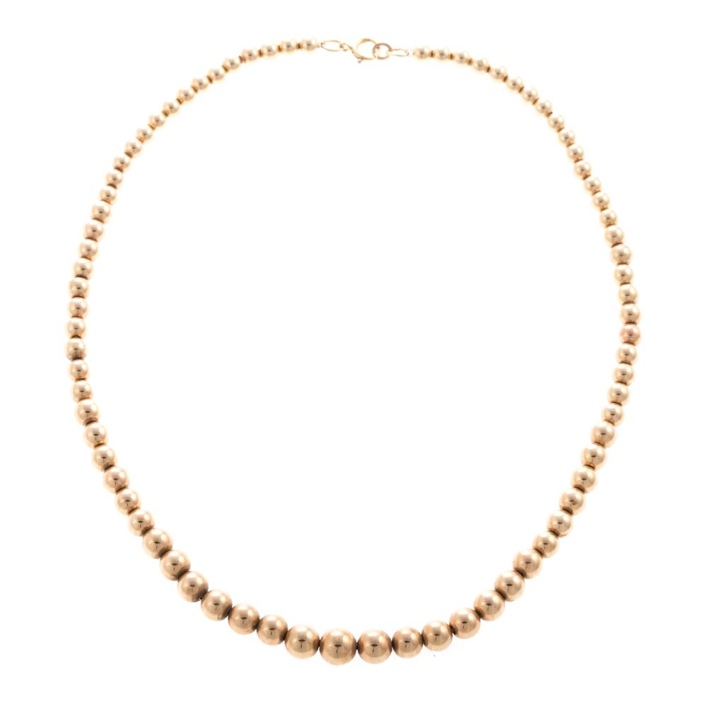 A Strand of Graduated 14K Gold Beads