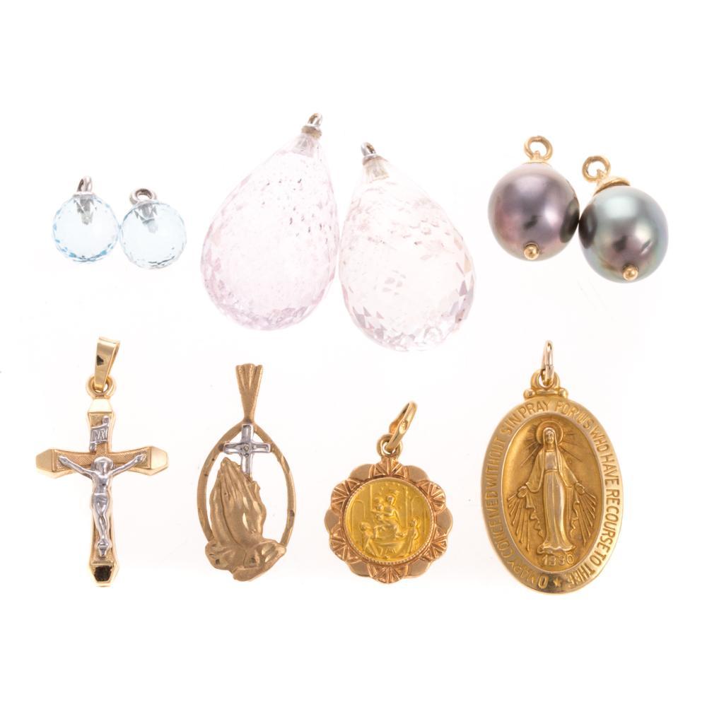 An Assortment of Gold Charms & Earring Pendants