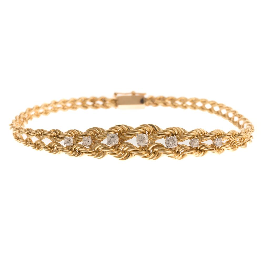 A Ladies Double Rope Bracelet with Diamonds in 14K