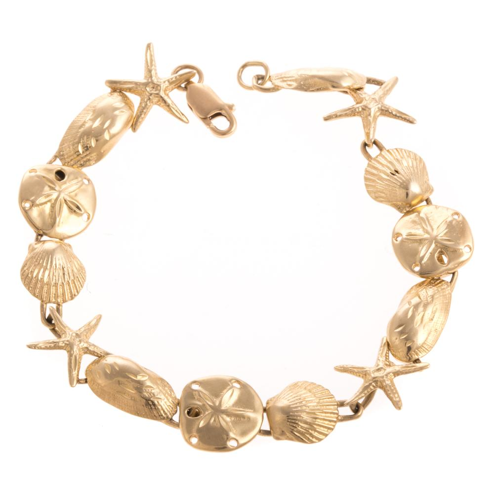 A Ladies Starfish & Seashell Bracelet in 14K Gold