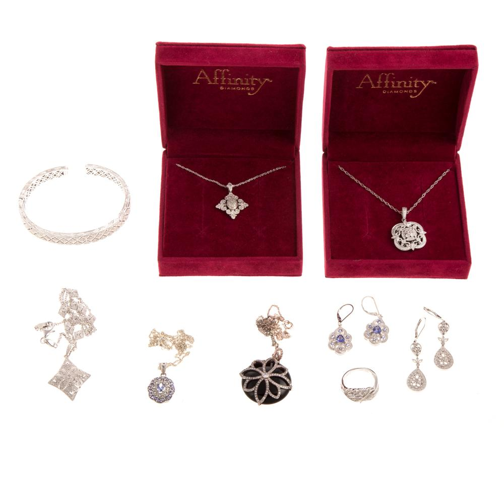 A Collection of Diamond & Sterling Silver Jewelry
