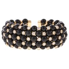 A Lady's Diamond & Black Onyx Bracelet in 18K Gold