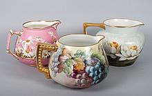 Three Continental porcelain jugs