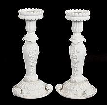 Pair of Rococo style bisque porcelain candlesticks