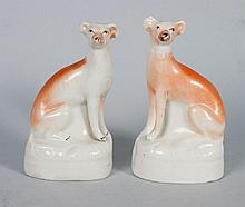 Pair of Staffordshire earthenware whippets