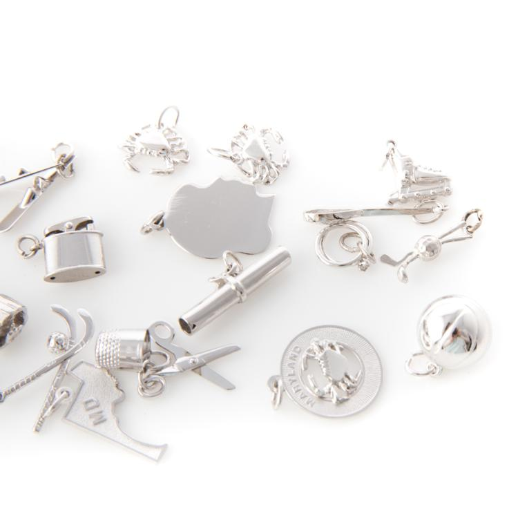 4 silver charm bracelets and assorted charms