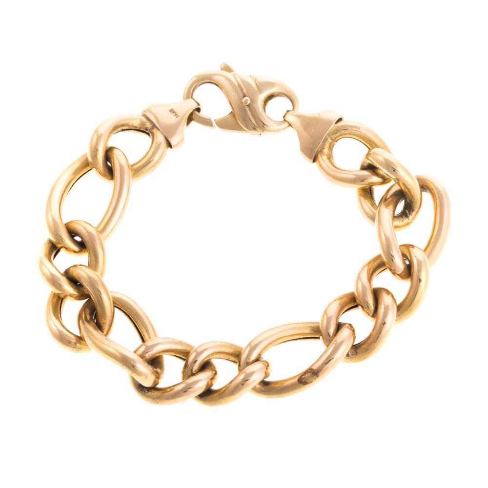 Lot 107: A Ladies Italian Curbed Link Bracelet in 14K
