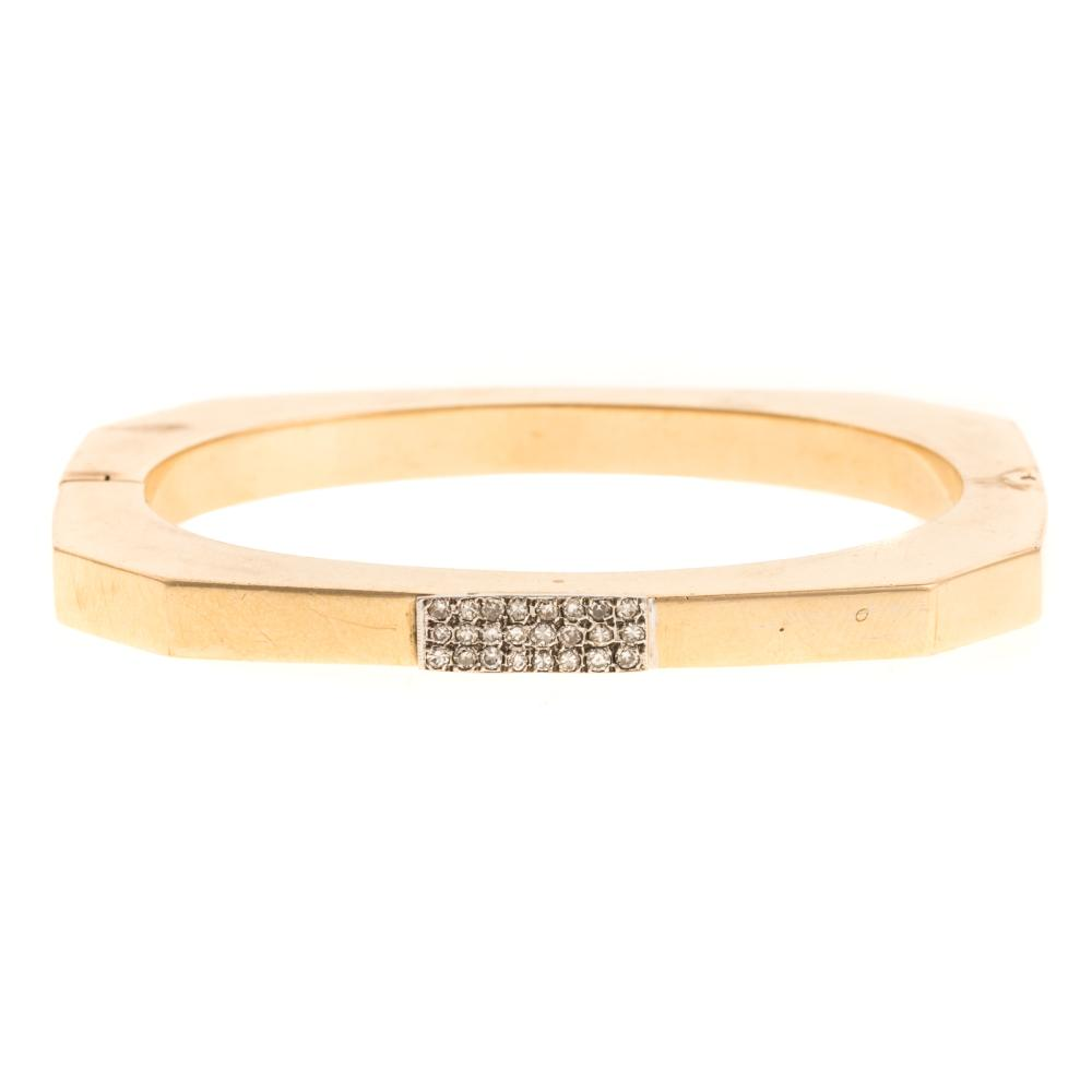 A Ladies Bangle Bracelet with Diamonds in 14K