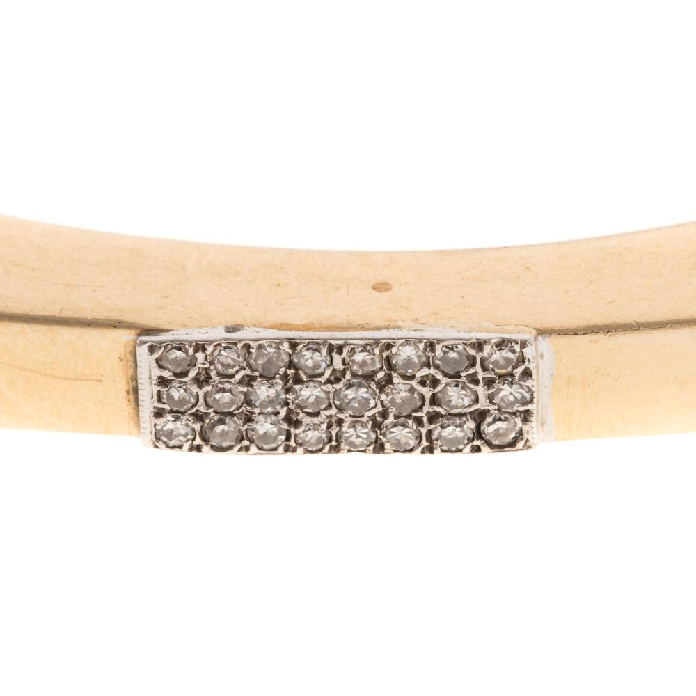 Lot 112: A Ladies Bangle Bracelet with Diamonds in 14K