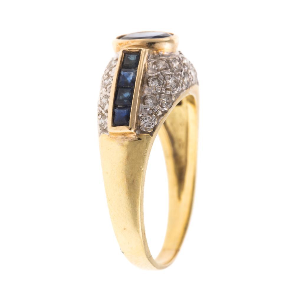 Lot 115: A Ladies 18K Sapphire & Diamond Dome Ring