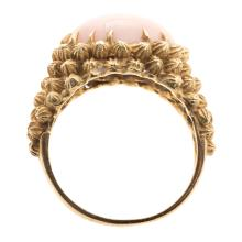 Lot 122: A Ladies 18K Angel Skin Coral Dome Ring