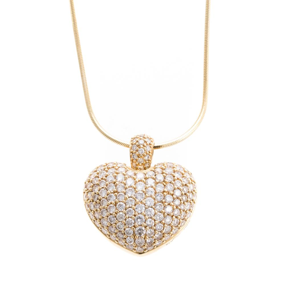 A Ladies 18K Pave Diamond Heart Pendant on Chain