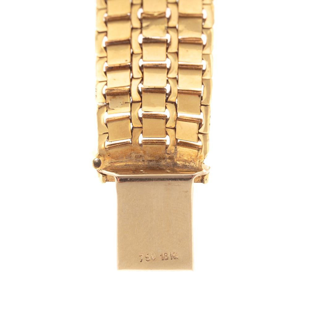 Lot 127: A Ladies Wide Brushed Finish Link Bracelet in 18K