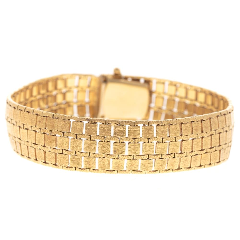 A Ladies Wide Brushed Finish Link Bracelet in 18K
