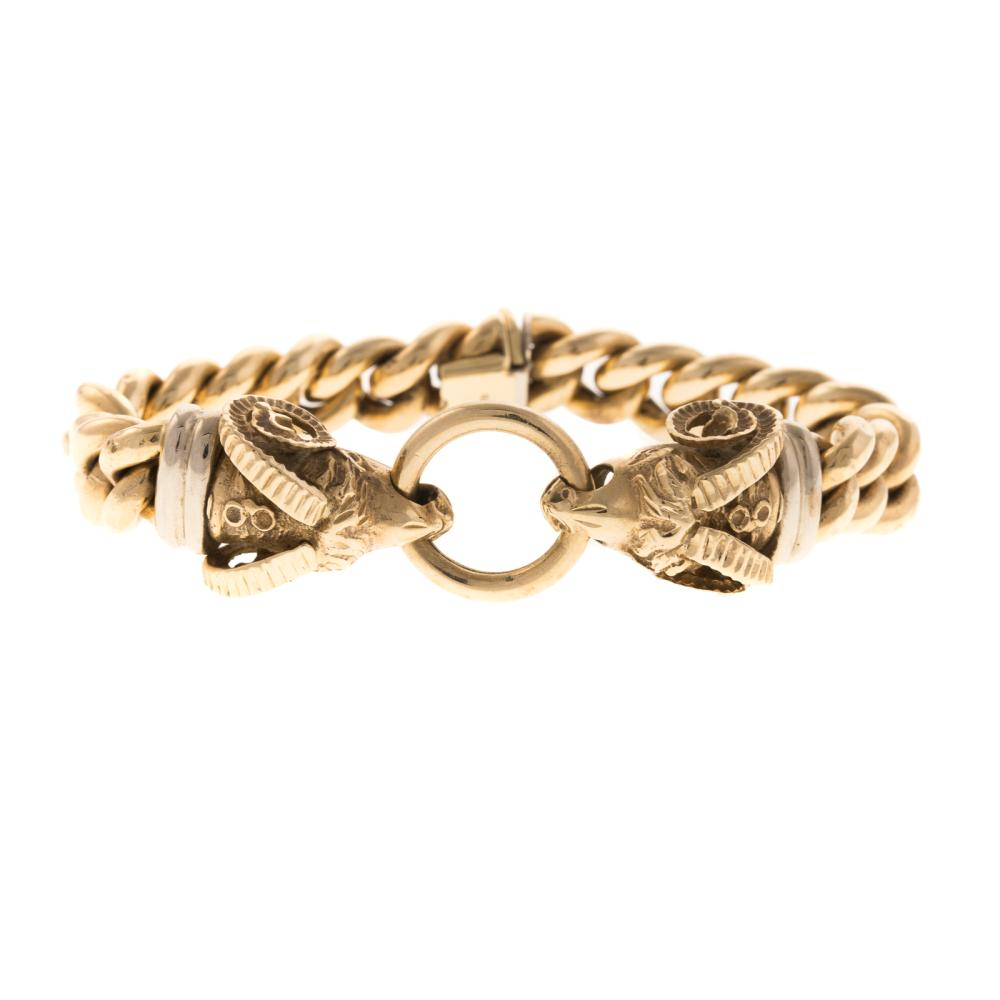 Lot 135: A Ladies Rams Head Curb Link Bracelet in 14K