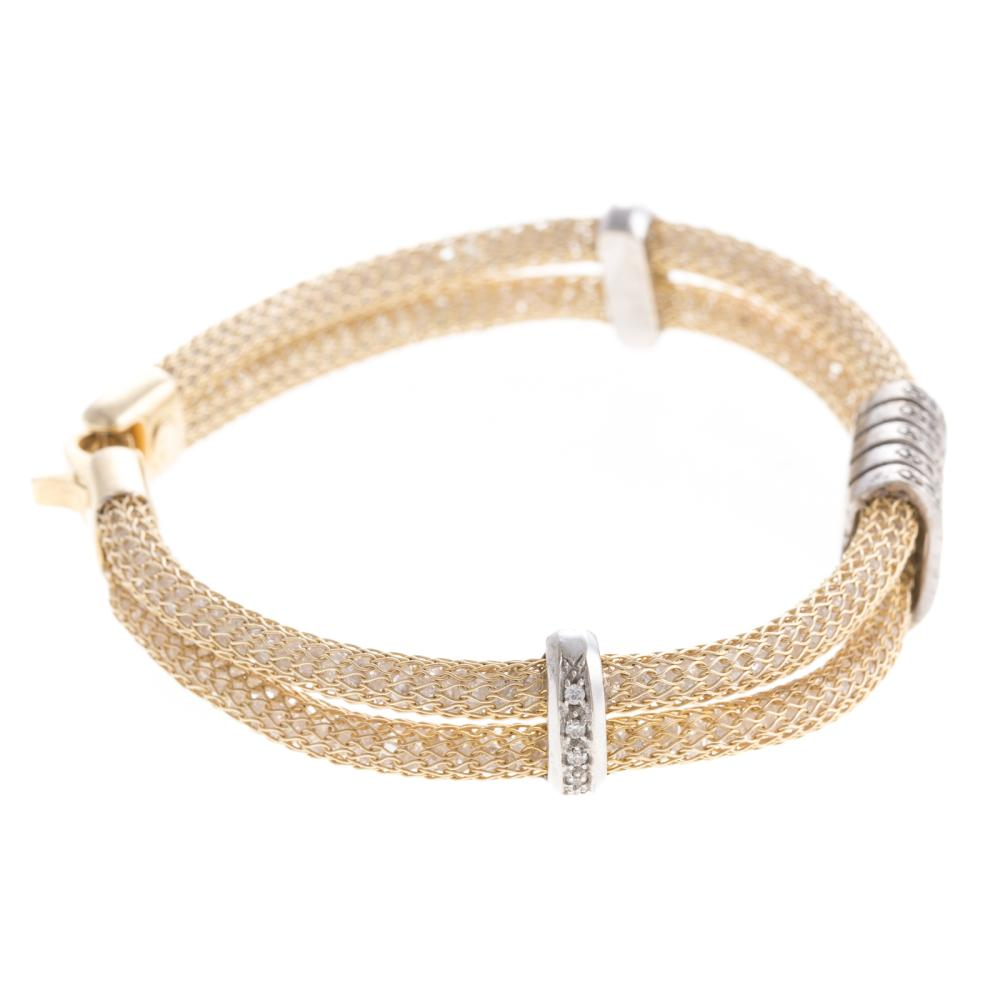 Lot 141: A Ladies Double Row Mesh & Diamond Bracelet in 14K