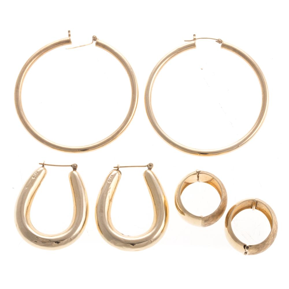 Lot 144: Three Pairs of Gold Hoop Earrings