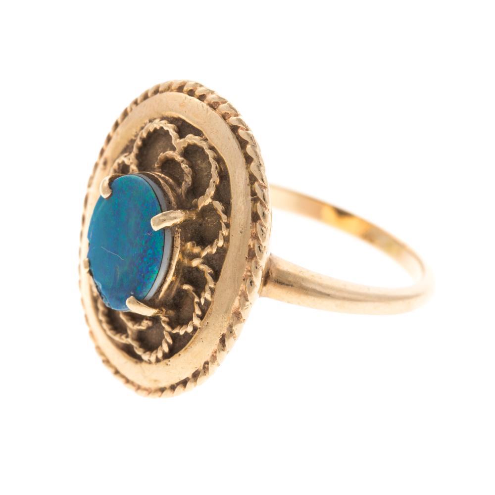 Lot 143: A Pair of Ladies Opal Rings in 14K