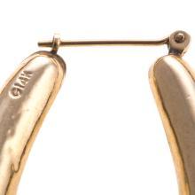 Lot 144: Three Pairs of Gold Hoop Earrings