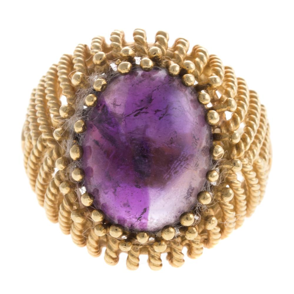 A Ladies Retro 18K Cabochon Amethyst Ring