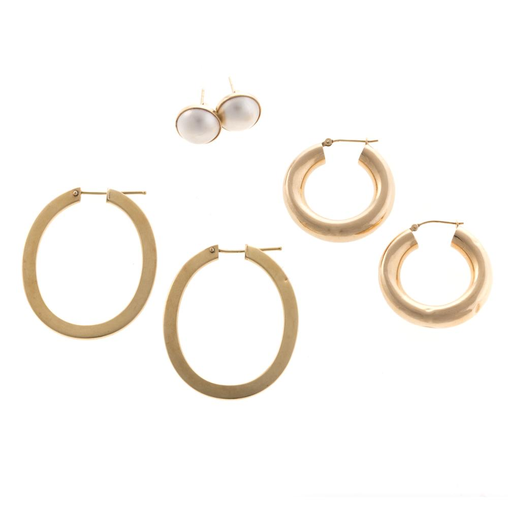 Two Pairs of Gold Hoops and Mabe Pearl Earrings