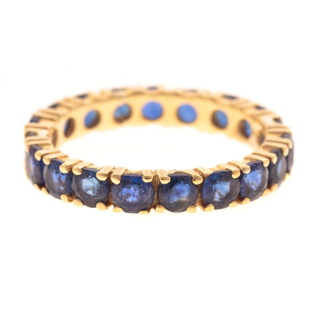 A Ladies Sapphire Eternity Band in 18K