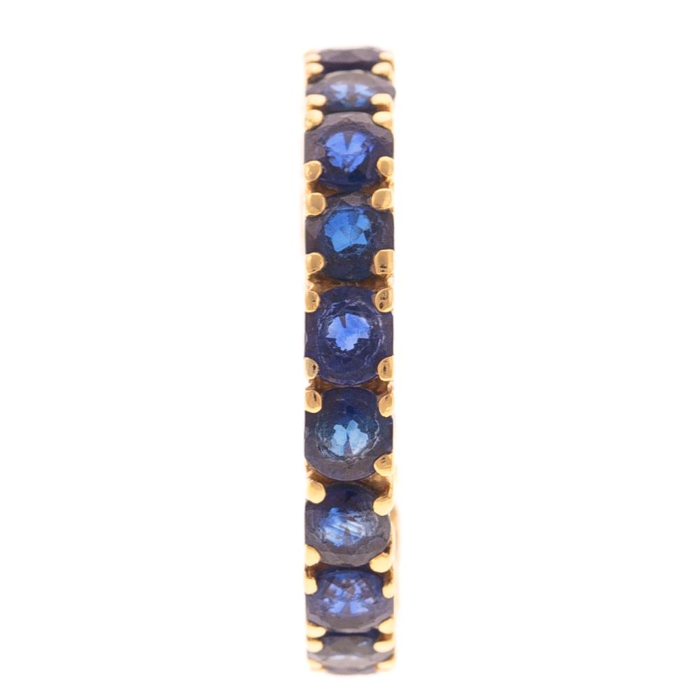 Lot 156: A Ladies Sapphire Eternity Band in 18K