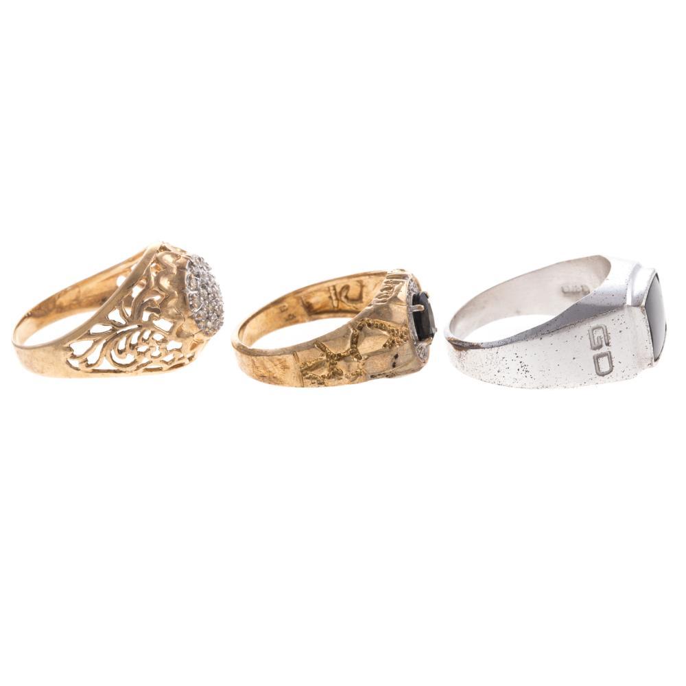 Lot 163: A Trio of Gentlemen's Rings with Diamonds