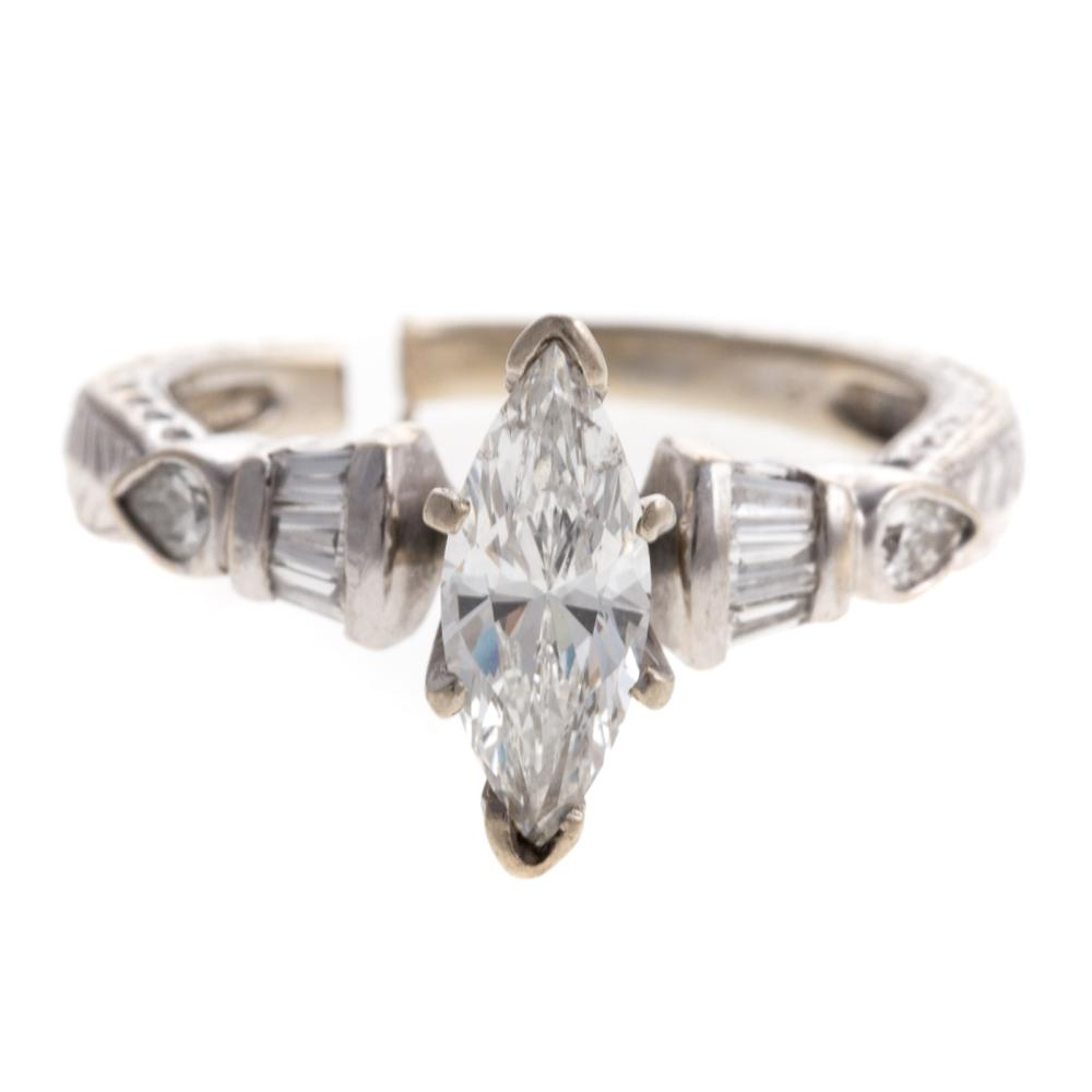 Lot 162: A Ladies Marquise Diamond Ring & Band