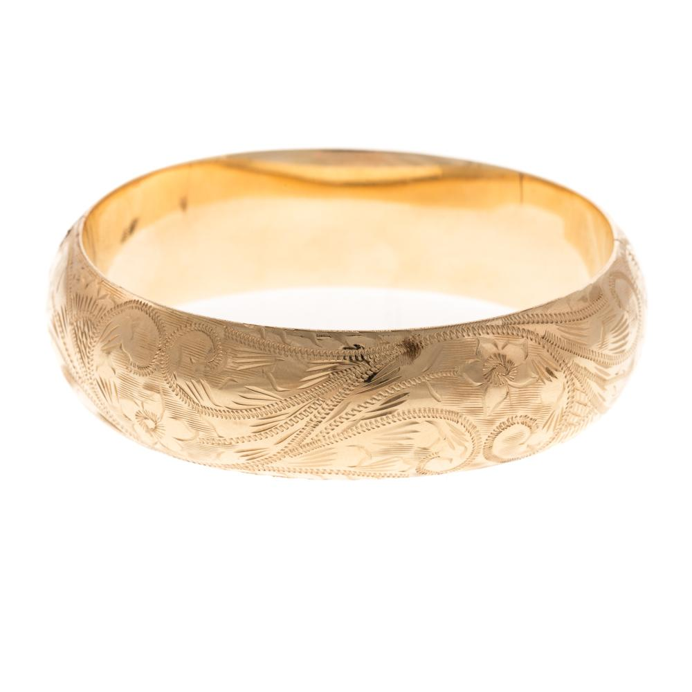 Lot 173: A Ladies Engraved Wide Bangle Bracelet in 14K