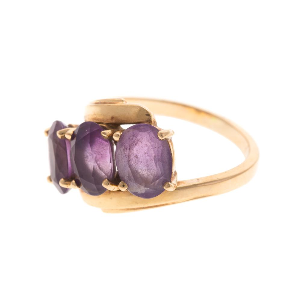 Lot 176: A Pair of Amethyst Earrings and Ring in Gold
