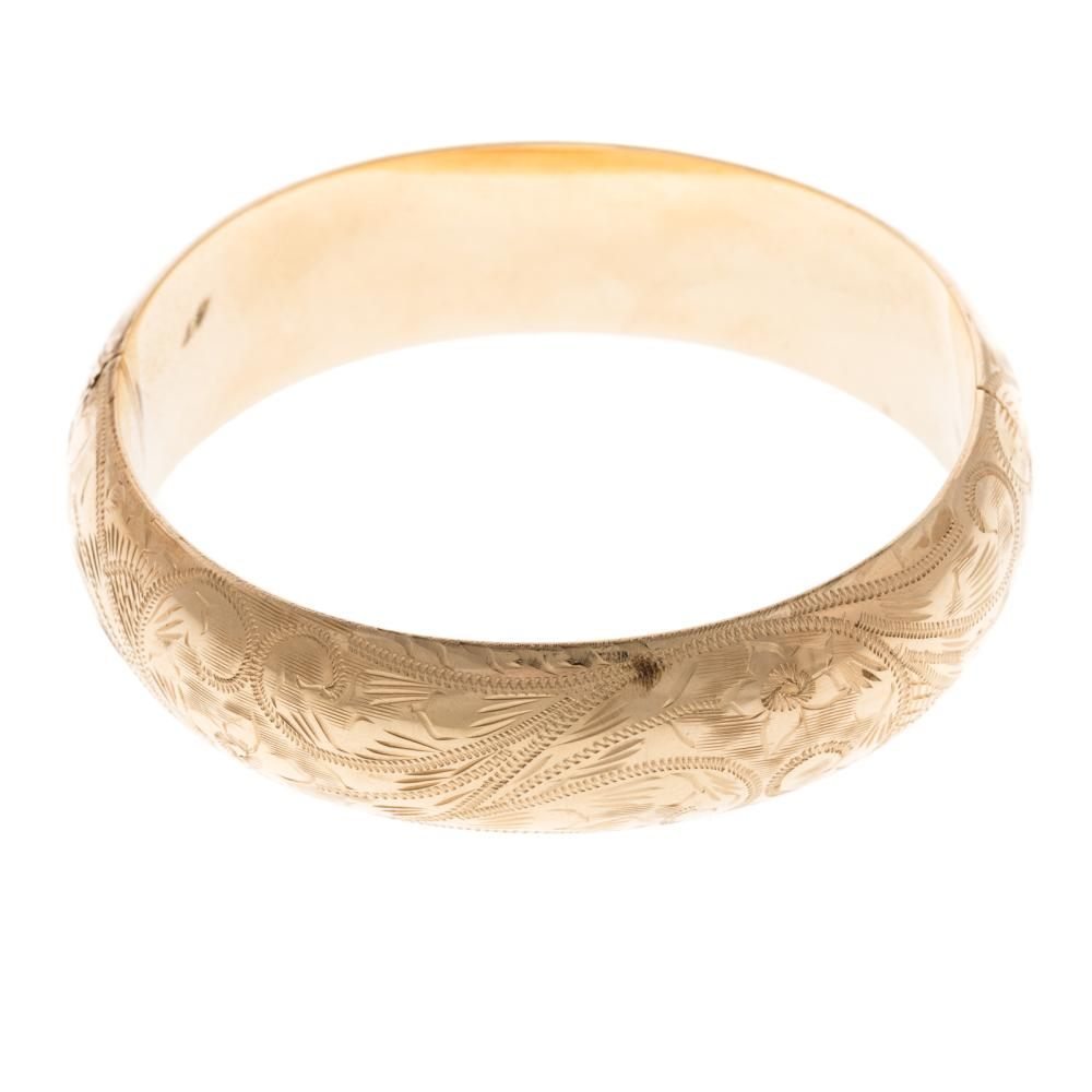 A Ladies Engraved Wide Bangle Bracelet in 14K